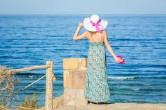 Beautiful pregnant girl in hat at sea background. A Beautiful pregnant girl in hat at sea background royalty free stock photos