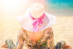 Beautiful pregnant girl in hat at sea background. A Beautiful pregnant girl in hat at sea background royalty free stock images