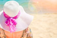 Beautiful pregnant girl in hat at sea background. A Beautiful pregnant girl in hat at sea background stock photo