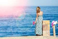 Beautiful pregnant girl in hat at sea background. A Beautiful pregnant girl in hat at sea background royalty free stock photo