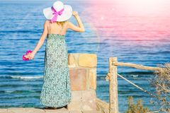Beautiful pregnant girl in hat at sea background. A Beautiful pregnant girl in hat at sea background stock images