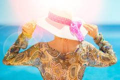 Beautiful pregnant girl in hat at sea background. Nice and Beautiful pregnant girl in hat at sea background stock photos