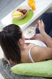 Beautiful pregnant girl having breakfast Stock Photos
