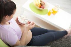 Beautiful pregnant girl having breakfast Stock Photo
