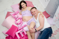 Pregnant girl and her boyfriend. Beautiful pregnant girl and her boyfriend Royalty Free Stock Image