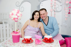 Pregnant girl and her boyfriend. Beautiful pregnant girl and her boyfriend Stock Images