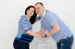 Pregnant girl and her boyfriend. Beautiful pregnant girl and her boyfriend Royalty Free Stock Photos