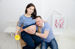Pregnant girl and her boyfriend. Beautiful pregnant girl and her boyfriend Royalty Free Stock Photography