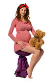 Beautiful pregnant girl hugging a toy Stock Photos