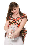Beautiful pregnant girl with iron on abdomen Stock Photography