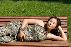 Beautiful pregnant girl lying on bench Stock Image