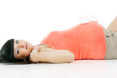 Beautiful pregnant girl lying with booties Stock Images