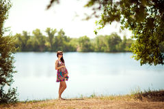 Pregnant girl near the lake Stock Photo