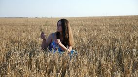 Beautiful pregnant girl in field