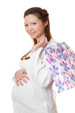 Beautiful pregnant girl with purchases. Stock Images