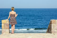 Beautiful pregnant girl at sea background. A Beautiful pregnant girl at sea background stock images