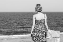 Beautiful pregnant girl at sea background. A Beautiful pregnant girl at sea background royalty free stock image