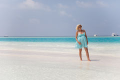 Beautiful pregnant girl is walking on sand bank Stock Photography