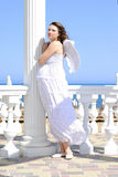 Beautiful pregnant with a girl with wings Stock Image