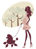 Beautiful pregnant lady walking with her poodle Stock Photos