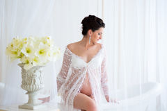 Beautiful pregnant in light white lace negligee in the bathroom Stock Photography