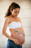 Beautiful pregnant model expecting newborn Royalty Free Stock Image