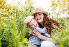 Beautiful pregnant mother with her cute little son. Royalty Free Stock Image