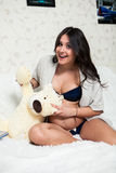 Beautiful pregnant mother with teddy bears Stock Images