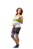 Beautiful pregnant redhead woman Stock Photo