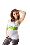 Beautiful pregnant redhead woman Stock Photos