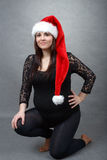 Beautiful pregnant santa woman tenderly holding her tummy Royalty Free Stock Images