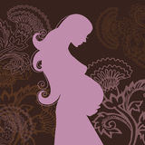 Beautiful pregnant woman. In flowers Royalty Free Stock Image