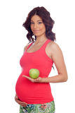 Beautiful pregnant woman with a apple Stock Photography