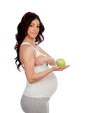 Beautiful pregnant woman with a apple Royalty Free Stock Photo