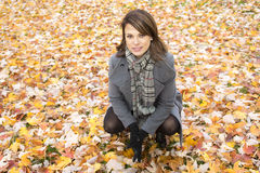 Beautiful pregnant woman in the autumn park royalty free stock photography