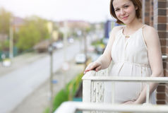 Beautiful pregnant woman on the balcony Stock Image