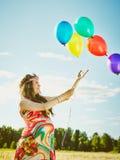Beautiful pregnant woman and balloons Royalty Free Stock Photos