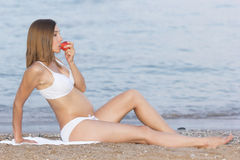 A beautiful pregnant woman on the beach Stock Photo