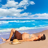 Beautiful pregnant woman on the beach Royalty Free Stock Image