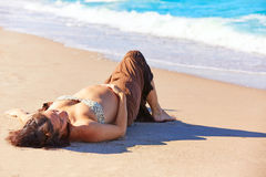 Beautiful pregnant woman on the beach Stock Image
