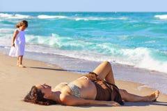Beautiful pregnant woman on the beach Stock Photo