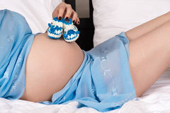Beautiful pregnant woman belly with bootees Stock Photography