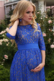 Beautiful pregnant woman with  blond hair in elegant lace dress Stock Images