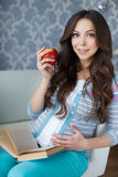Beautiful pregnant woman with a book in his hands Stock Images