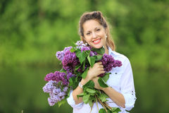 Beautiful pregnant woman with bunch of lilac Stock Photography