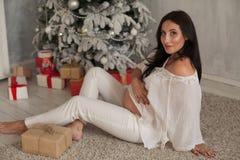 Beautiful pregnant woman childbirth on Christmas New Year holiday gifts. Beautiful pregnant woman childbirth on Christmas New gifts royalty free stock image