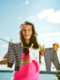 Beautiful pregnant woman and children clothes Stock Image