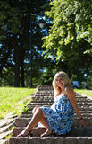 Beautiful pregnant woman in city park Royalty Free Stock Image