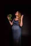 Beautiful pregnant woman on a dark background Royalty Free Stock Images