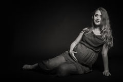 Beautiful pregnant woman on a dark background Stock Photos